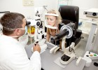 7709950_l- Doctor,examining a patient in ophthalmology laboratory
