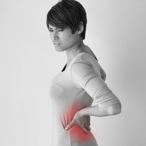 32815443 - woman suffers from backpain, concept of office syndrome, spinal or lower back problem